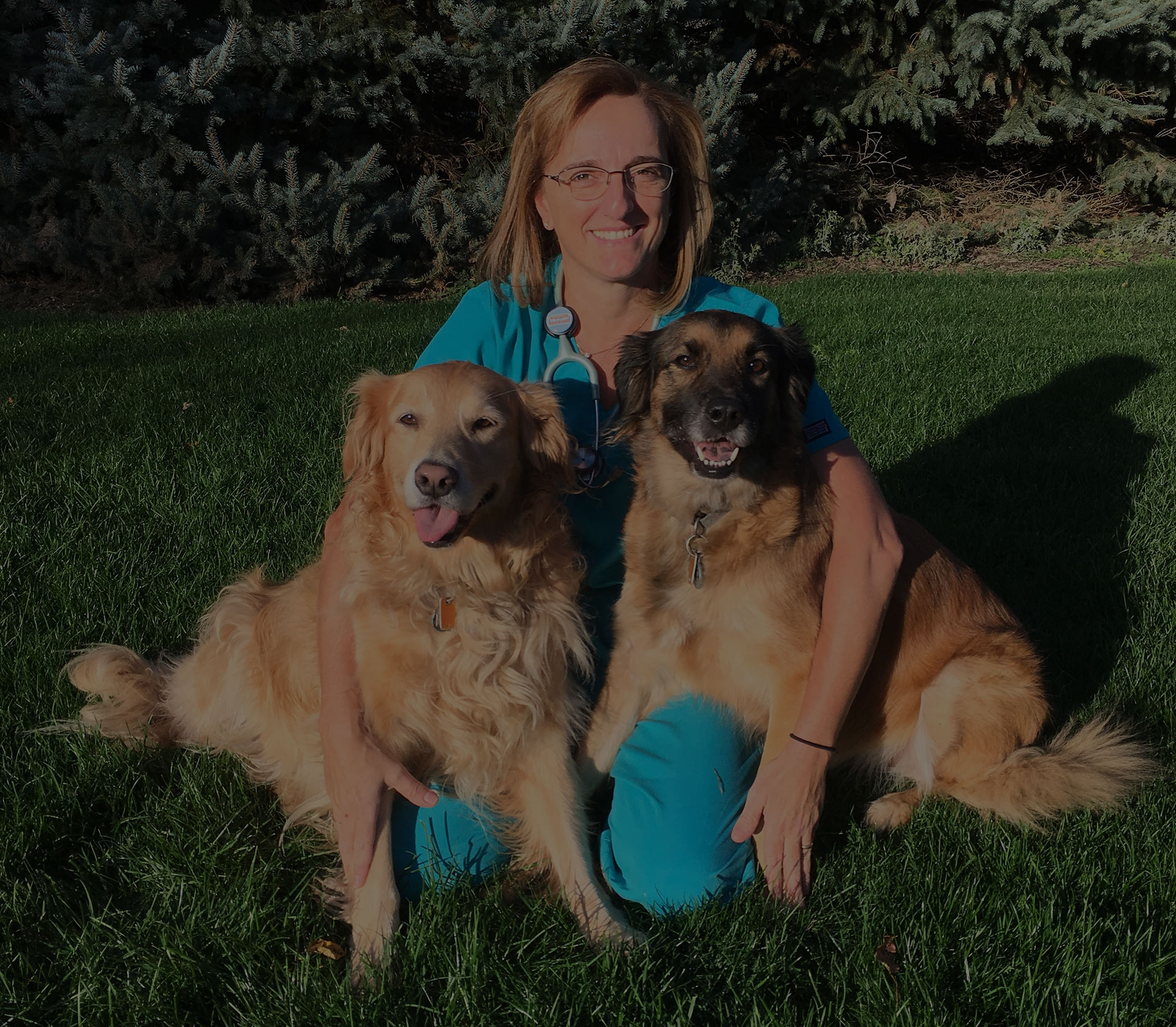 Maria with her two dogs